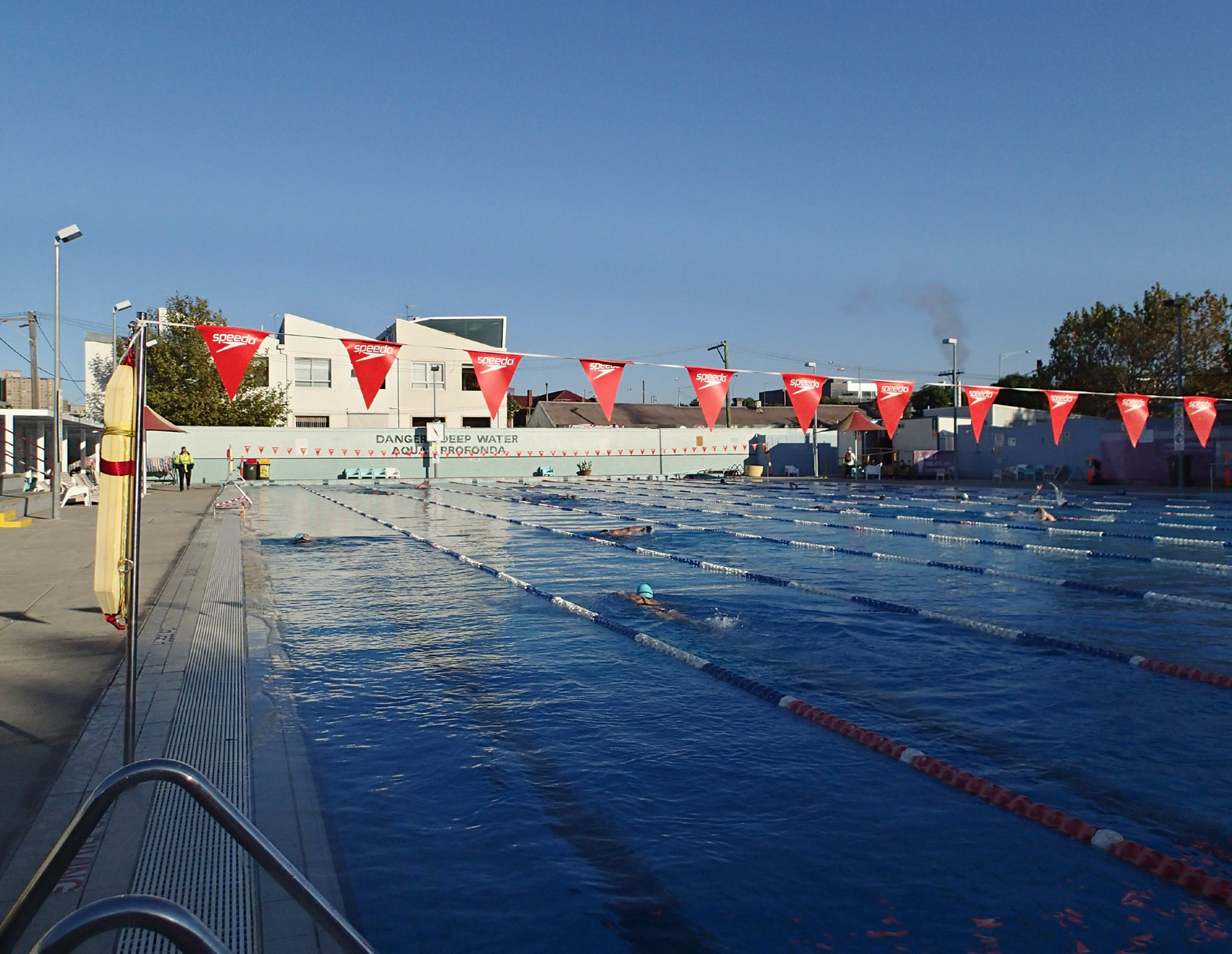 Outdoor swimming pool, with swimmers