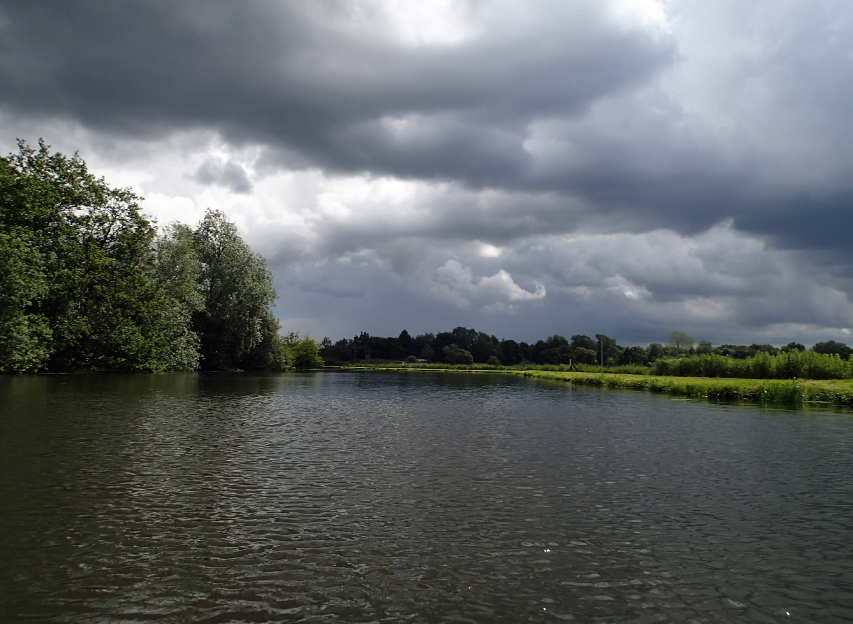 wide calm river with cloudy sky