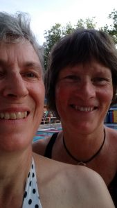 faces of two swimmers at lido