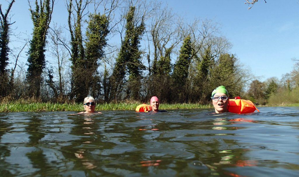 swimmers in a river