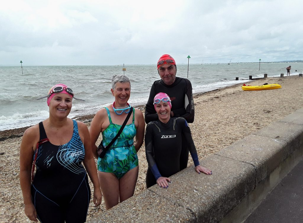 four swimmers at the sea