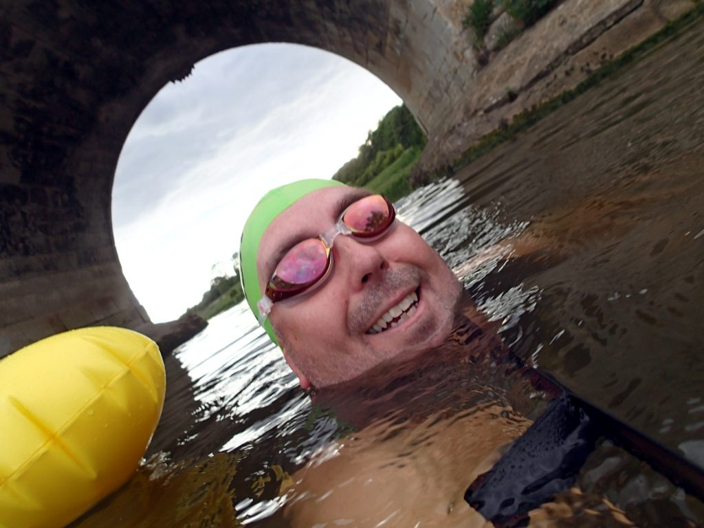 swimmer under bridge