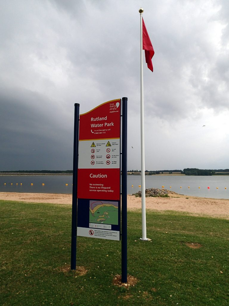 sign with lake in background
