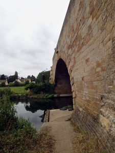 river and ancient stone bridge