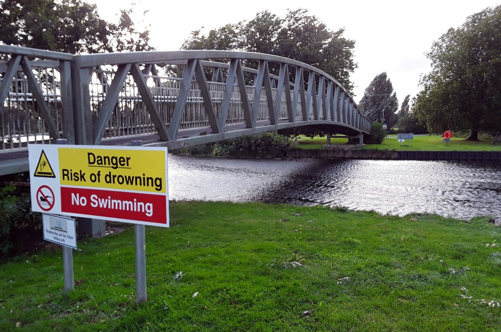 bridge and Danger No Swimming sign