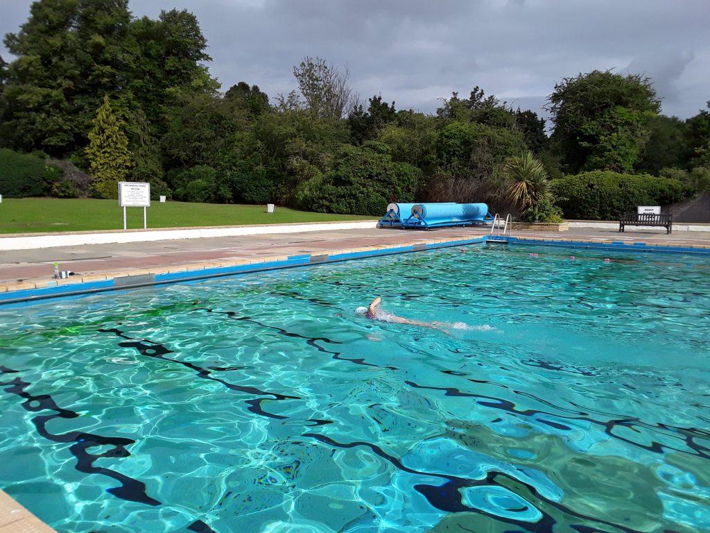 swimmer in blue green water