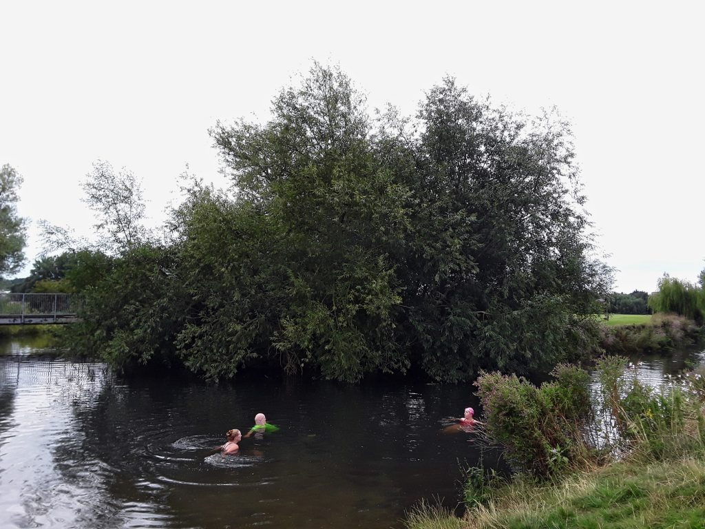 swimmers in a river pool