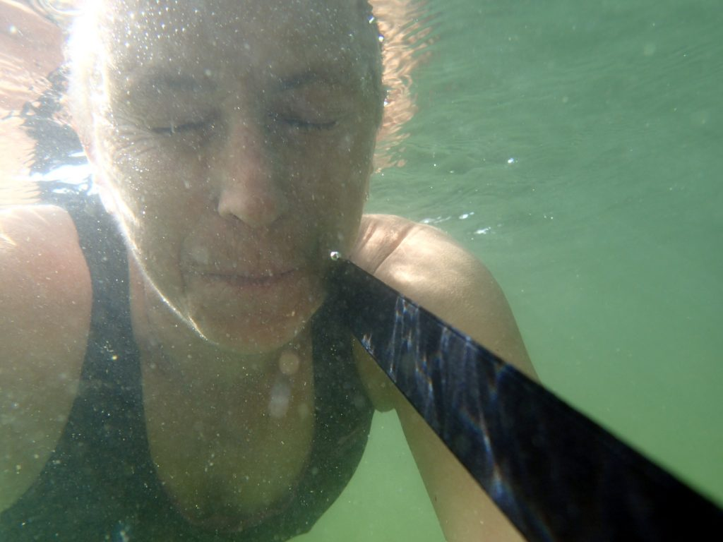 swimmer with goggles underwater
