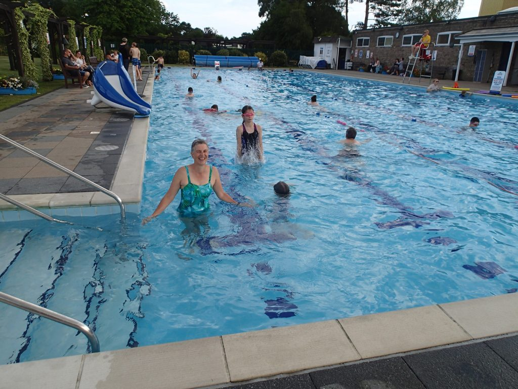 a lido with many young people and adults