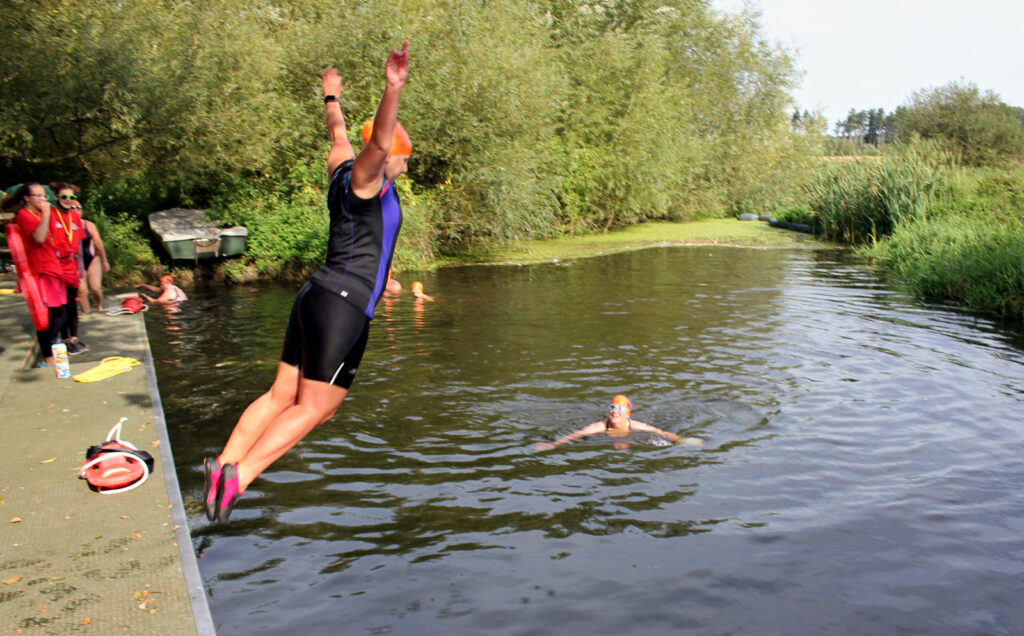 swimmer jumping in