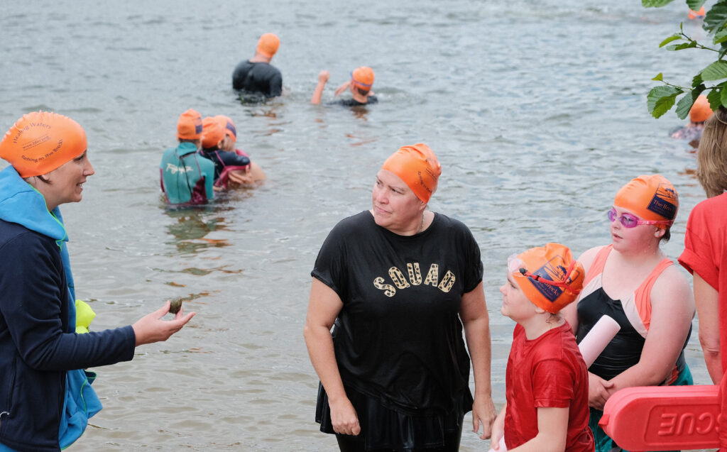 swimmers with volunteer