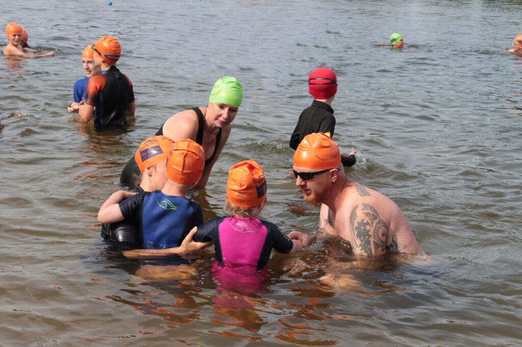 children and parents in water