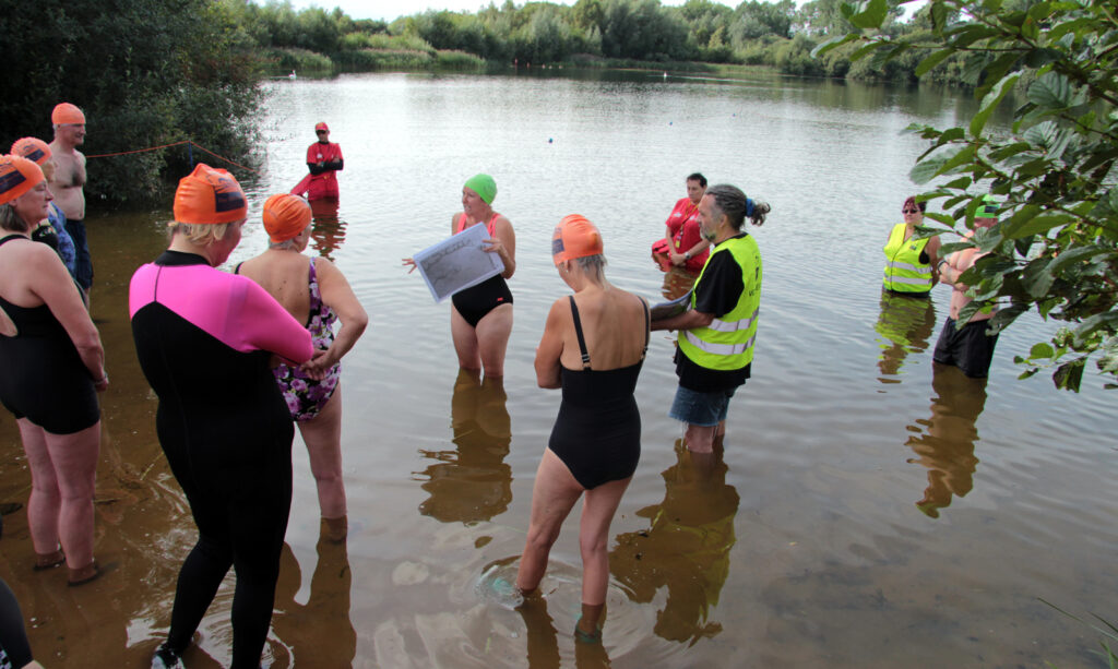 swimmers discussion on waters edge