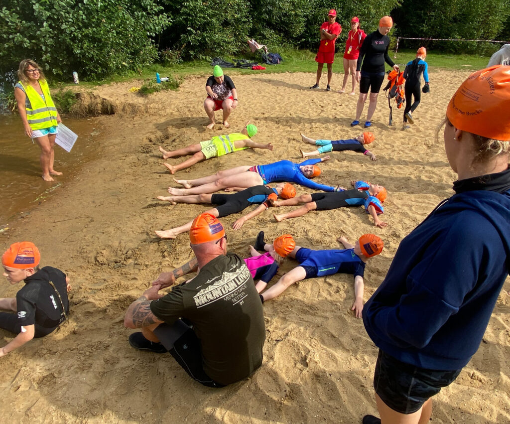 children lying on beach